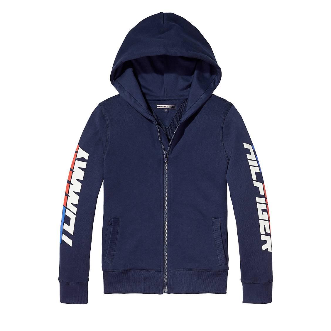 38d044bd77a Sweat zippé à capuche Tommy Hilfiger en coton bleu marine floqué sur les  manches ...