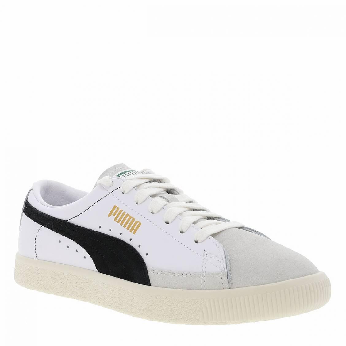 Baskets Puma en cuir blanc, semelle beige et détails noirs | Rue ...