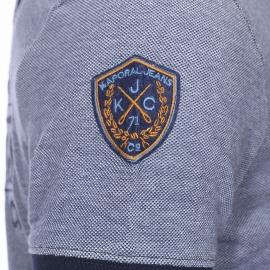 Polo Kaporal en maille piquée mélangée de bleu marine, blanc et bleu gris brodé dans le dos