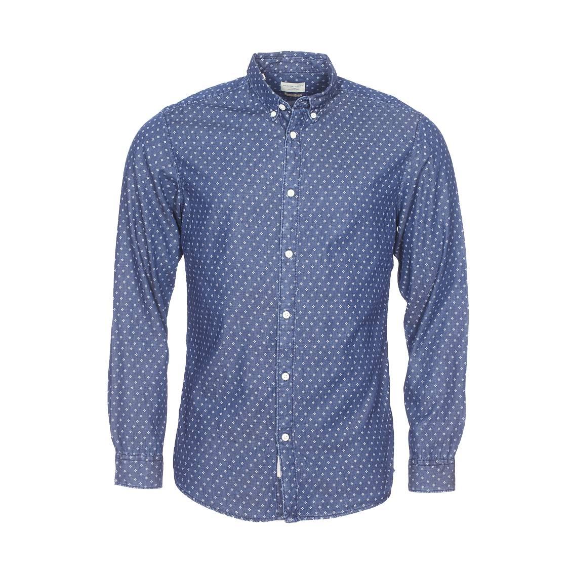 Chemise cintrée  bleu jean brut à motifs blancs